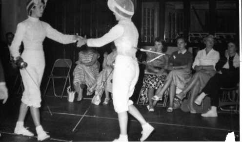 Barbara McCreath Victor over Denise O'Brien (Left), Foreground: Winter Family. (All fencers and spectators from Salla Bella Vista Club)