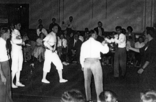 1958 Sabre Championships. Graham McKenzie vs Richard Porebsky. Presiding E. Santo. Far Left: Jock Gibson Professional Fencing Coach (Ex. Olympian)