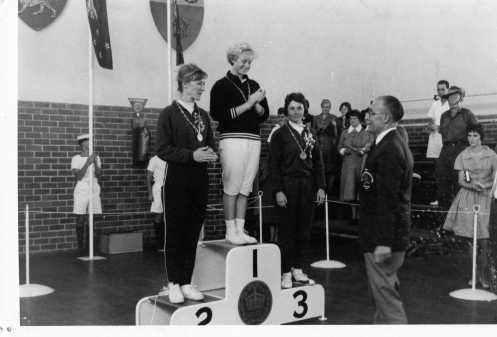 3 Medalist on Podium. L-R: J. Winter, D. Coleman, J. Hopner, C. De Beaument (Presenter)